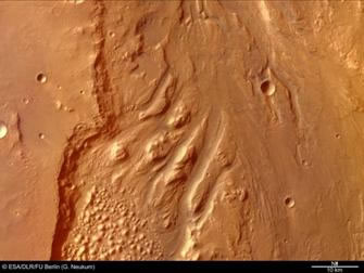 Image of outflow channels cut by flood waters in Ares Vallis.