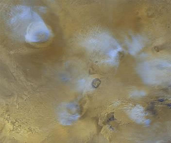 Image of Olympus Mons and volcanoson the Tharsis bulge.
