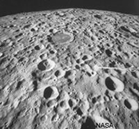 Impact craters on the lunar surface.