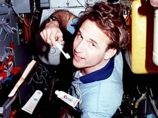 Researcher brushing his teeth.  Credit: NASA, Welcome to Shuttle Mir