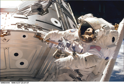 Astronaut holds one of the hand rails on the Unity connecting module during the early stages of a 7-hour spacewalk.  Credit: NASA, STS088-E-5056 (12-07-98), STS-88 Shuttle Mission Imagery