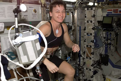 Astronaut exercising aboard the International Space Station.  Credit: NASA, Your Body in Space: Use it or Lose It