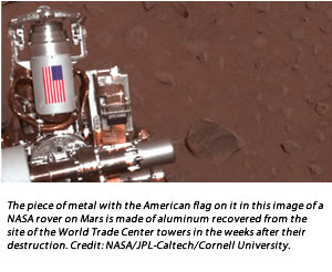 The piece of metal with the American flag on it in this image of a NASA rover on Mars is made of aluminum recovered from the site of the World Trade Center towers in the weeks after their destruction. Credit: NASA/JPL-Caltech/Cornell University.
