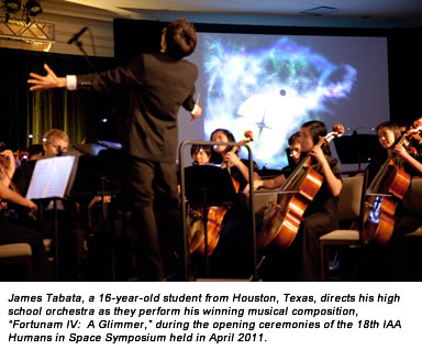 "James Tabata, a 16-year-old student from Houston, Texas, directs his high school orchestra as they perform his winning musical composition, ""Fortunam IV:  A Glimmer,"" during the opening ceremonies of the 18th IAA Humans in Space Symposium held in April 2011."