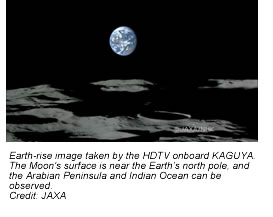 Earth-rise image taken by the HDTV onboard KAGUYA. The Moon's surface is near the Earth's north pole, and the Arabian Peninsula and Indian Ocean can be observed.