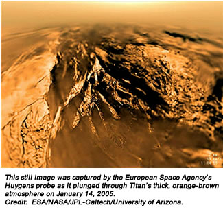 This still image was captured by the European Space Agency's Huygens probe as it plunged through Titan's thick, orange-brown atmosphere on January 14, 2005. Credit:  ESA/NASA/JPL-Caltech/University of Arizona.