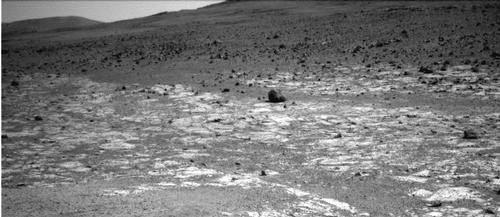 "This view from NASA's Mars Exploration Rover Opportunity shows an area where a pale-toned geological unit called the ""Burns Foundation,"" in the foreground, abuts a different geological unit."