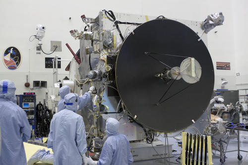 Engineers work on the MAVEN spacecraft, which is dominated by the high-gain antenna that is crucial to communications with NASA's Deep Space Network. Image Credit: NASA/Kim Shiflett.