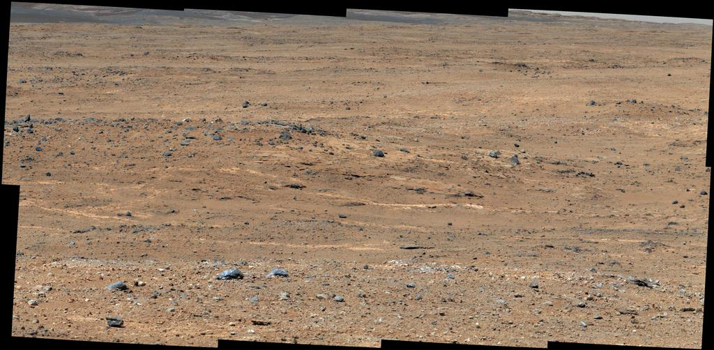 An outcrop visible as light-toned streaks in the lower center of this image has been chosen as a place for NASA's Mars rover Curiosity to study for a few days in September 2013. Image credit: NASA/JPL-Caltech/MSSS.