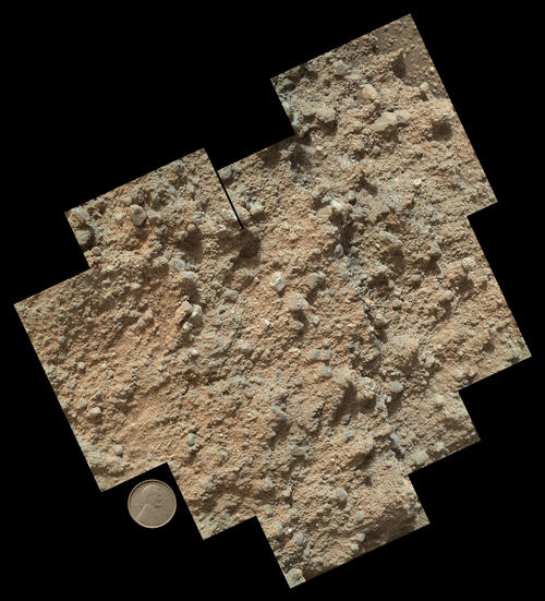 This mosaic of nine images, taken by the Mars Hand Lens Imager (MAHLI) camera on NASA's Mars rover Curiosity, shows detailed texture in a conglomerate rock bearing small pebbles and sand-size particles. Image Credit: NASA/JPL-Caltech/MSSS.