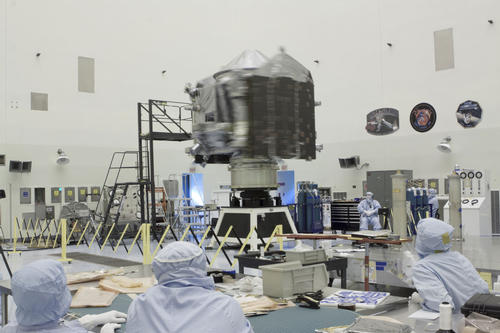 Inside the Payload Hazardous Servicing Facility at NASA's Kennedy Space Center in Florida, engineers and technicians perform a spin test of the Mars Atmosphere and Volatile Evolution, or MAVEN, spacecraft. Image credit: NASA.