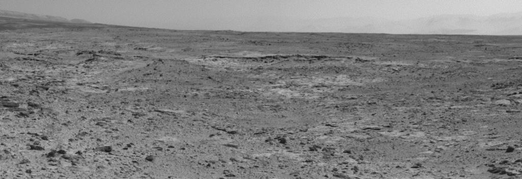 "The low ridge that appears as a dark band below the horizon in the center of this scene is a Martian outcrop called ""Cooperstown,"" a possible site for contact inspection with tools on the robotic arm of NASA's Mars rover Curiosity. Image credit: NASA."