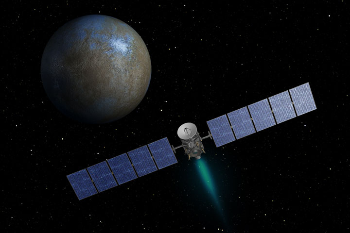 This artist's concept shows NASA's Dawn spacecraft heading toward the dwarf planet Ceres. Dawn spent nearly 14 months orbiting Vesta, the second most massive object in the main asteroid belt between Mars and Jupiter, from 2011 to 2012. Image credit: NASA.