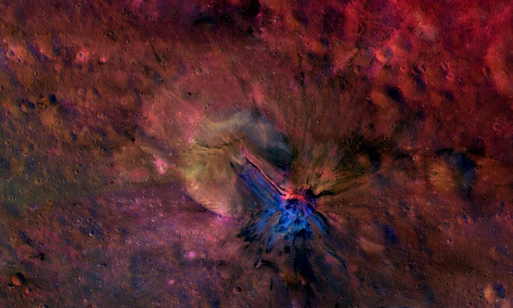 This colorful composite image from NASA's Dawn mission shows the flow of material inside and outside a crater called Aelia on the giant asteroid Vesta. Image Credit: NASA/JPL-Caltech/UCLAMPS/DLR/IDA.