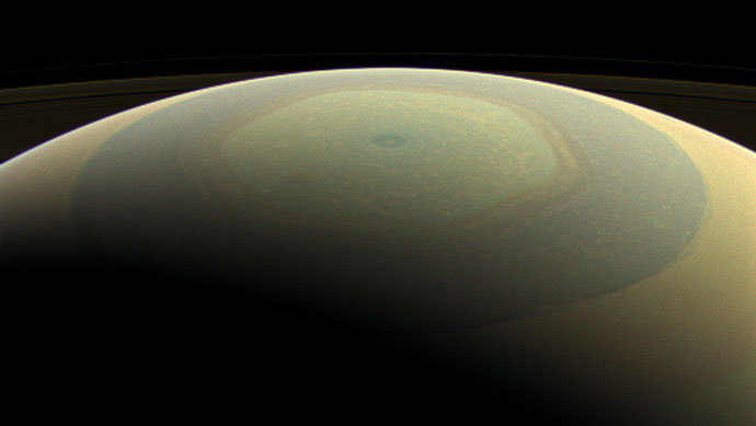 The characteristic hexagonal shape of Saturn's northern jet stream, somewhat yellow here, is visible. At the pole lies a Saturnian version of a high-speed hurricane, eye and all. Credit: NASA/JPL-Caltech/Space Science Institute.