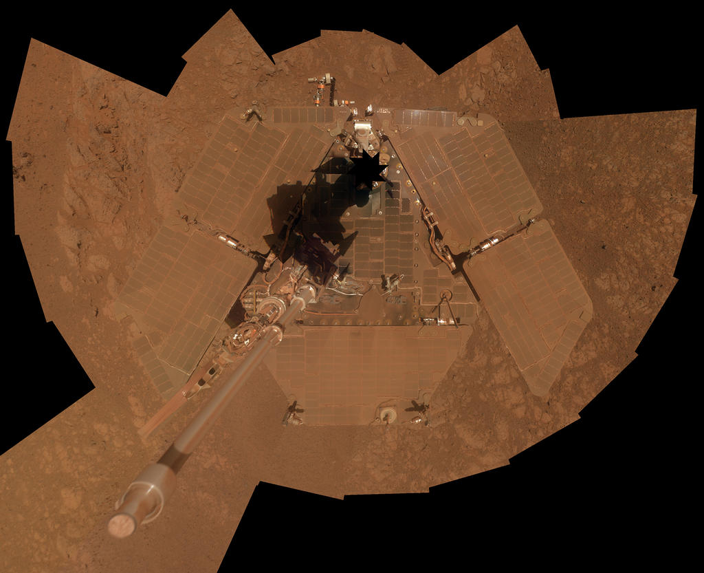 NASA's Mars Exploration Rover Opportunity recorded the component images for this self-portrait about three weeks before completing a decade of work on Mars. The rover's panoramic camera (Pancam) took the images during the interval Jan. 3, 2014, to Jan. 6, 2014, a few days after winds removed some of the dust that had been accumulating on the rover's solar panels. This image is presented as a vertical projection. The mast on which the Pancam is mounted does not appear in the image, though its shadow does. Image Credit: NASA/JPL-Caltech/Cornell Univ./Arizona State Univ.