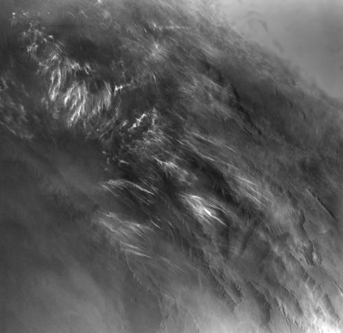 No NASA Mars orbiter has been in a position to observe morning daylight on Mars since the twin Viking orbiters of the 1970s. This image, taken by Viking Orbiter 1 on Aug. 17, 1976, shows water-ice clouds in the Valles Marineris area of equatorial Mars during local morning time. North is to the upper left, and the scene is about 600 miles (about 1,000 kilometers) across. Image Credit: NASA/JPL.