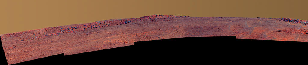 "The boulder-studded ridge in this scene recorded by NASA's Mars Exploration Rover Opportunity is ""McClure-Beverlin Escarpment,"" informally named for Jack Beverlin and Bill McClure, engineers who on Feb. 14, 1969, risked their lives to save NASA's second successful Mars mission, Mariner 6, on its launch pad. Image Credit: NASA/JPL-Caltech/Cornell Univ./Arizona State Univ."