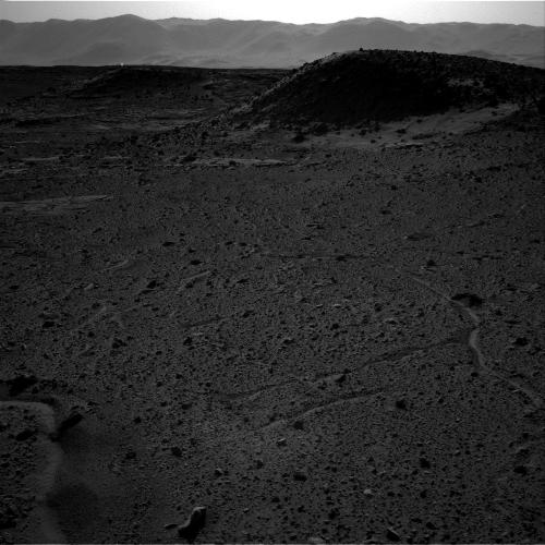 This image from NASA's Curiosity Mars rover, taken on April 3, 2014, includes a bright spot near the upper left corner. Possible explanations include a glint from a rock or a cosmic-ray hit. Image Credit: NASA/JPL-Caltech.