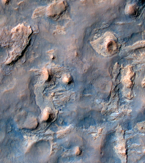 NASA's Curiosity Mars rover and tracks from its driving are visible in this view from orbit, acquired on April 11, 2014, by the High Resolution Imaging Science Experiment (HiRISE) camera on NASA's Mars Reconnaissance Orbiter. Image Credit: NASA/JPL-Caltech/Univ. of Arizona.