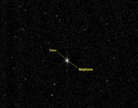 The New Horizons spacecraft captured this view of the giant planet Neptune and its large moon Triton on July 10, 2014, from a distance of about 2.45 billion miles (3.96 billion kilometers) - more than 26 times the distance between the Earth and sun. The 967-millisecond exposure was taken with the New Horizons telescopic Long-Range Reconnaissance Imager (LORRI).  Image credit: NASA/Johns Hopkins University Applied Physics Laboratory/Southwest Research Institute.