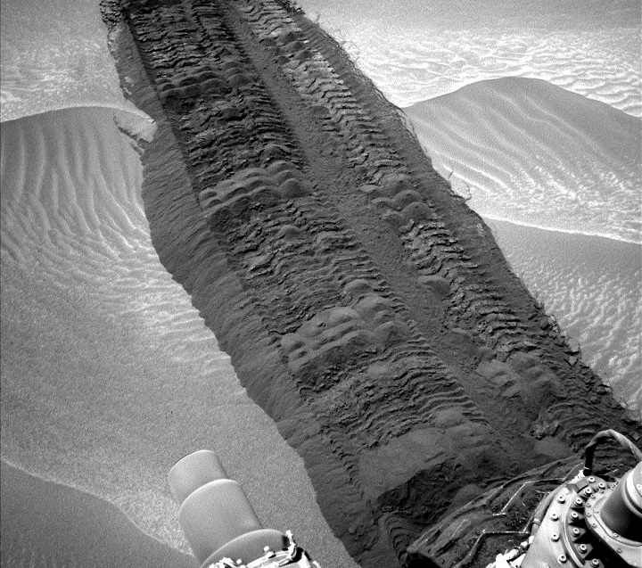 "This image from the Navigation Camera on NASA's Curiosity Mars rover shows wheel tracks printed by the rover as it drove on the sandy floor of a lowland called ""Hidden Valley"" on the route toward Mount Sharp. The image was taken on Aug. 4, 2014. Image Credit: NASA/JPL-Caltech."