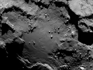 Close up detail focusing on a smooth region on the 'base' of the 'body' section of comet 67P/Churyumov-Gerasimenko. The image was taken by Rosetta's Onboard Scientific Imaging System (OSIRIS) on August 6, 2014. Image Credit: ESA/Rosetta/MPS for OSIRIS Team.