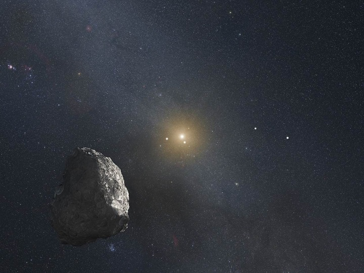 This is an artist's impression of a Kuiper Belt object (KBO), located on the outer rim of our solar system at a staggering distance of 4 billion miles from the Sun. A HST survey uncovered three KBOs that are potentially reachable by NASA's New Horizons spacecraft after it passes by Pluto in mid-2015. Image Credit: NASA, ESA, and G. Bacon (STScI).