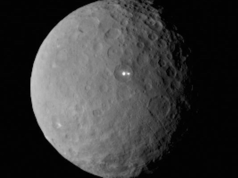 This image was taken by NASA's Dawn spacecraft of dwarf planet Ceres on Feb. 19 from a distance of nearly 29,000 miles (46,000 kilometers). It shows that the brightest spot on Ceres has a dimmer companion, which apparently lies in the same basin. Image Credit: NASA/JPL-Caltech/UCLA/MPS/DLR/IDA.