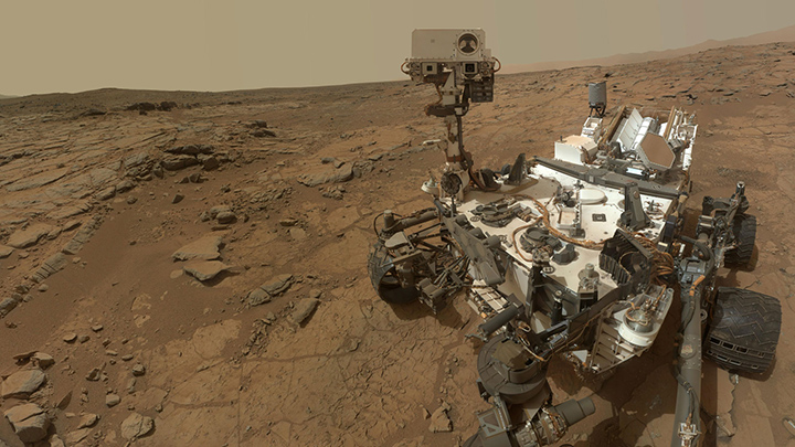 This self-portrait of NASA's Mars rover Curiosity combines dozens of exposures taken by the rover's Mars Hand Lens Imager (MAHLI) during the 177th Martian day, or sol, of Curiosity's work on Mars (Feb. 3, 2013), plus three exposures taken during Sol 270 (May 10, 2013) to update the appearance of part of the ground beside the rover. Image credit: NASA.