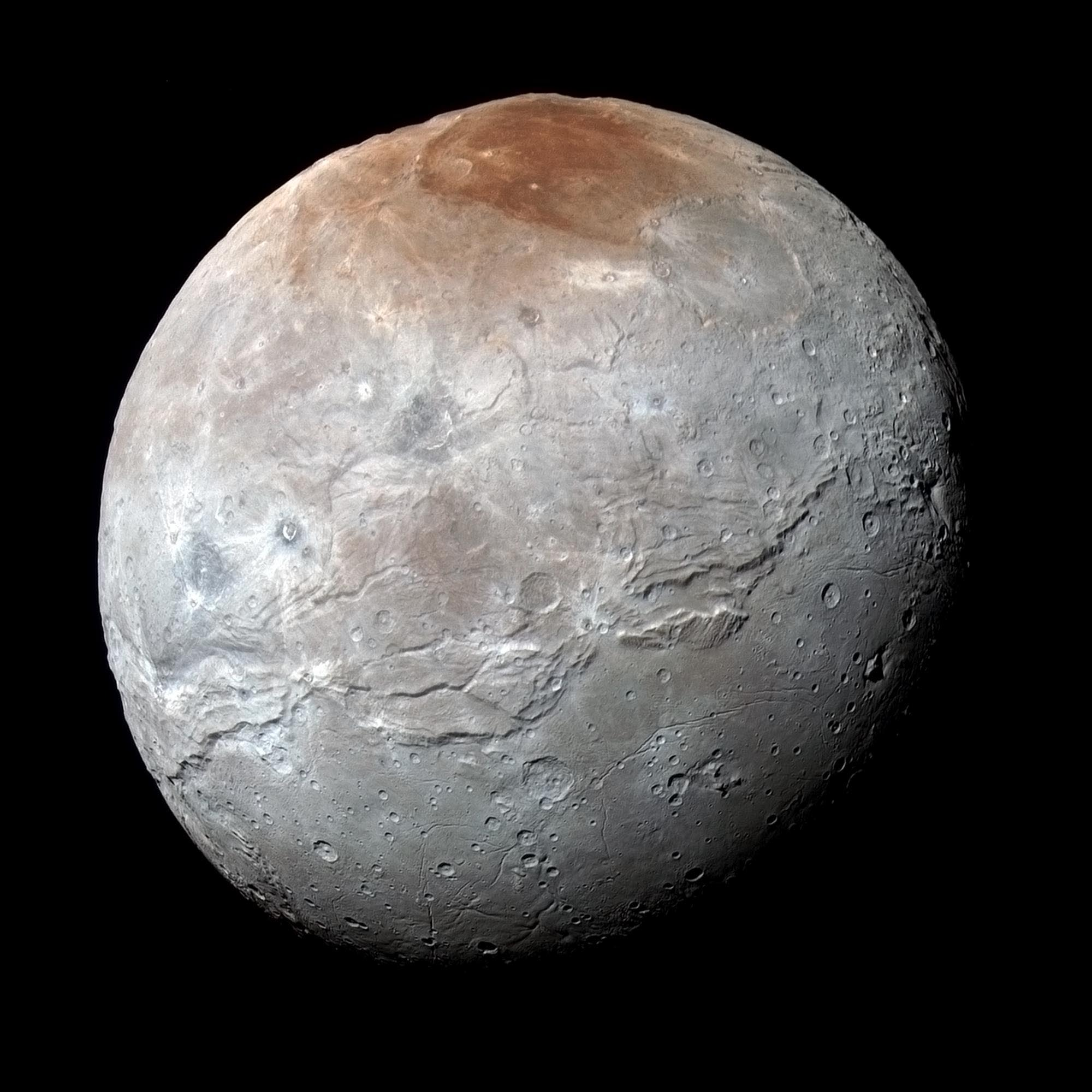 This composite of enhanced color images of Pluto (lower right) and Charon (upper left), was taken by NASA's New Horizons spacecraft as it passed through the Pluto system on July 14, 2015. This image highlights the striking differences between Pluto and Charon. The color and brightness of both Pluto and Charon have been processed identically to allow direct comparison of their surface properties, and to highlight the similarity between Charon's polar red terrain and Pluto's equatorial red terrain. Pluto and Charon are shown with approximately correct relative sizes, but their true separation is not to scale. The image combines blue, red and infrared images taken by the spacecraft's Ralph/Multispectral Visual Imaging Camera (MVIC). Credits: NASA/JHUAPL/SwRI.