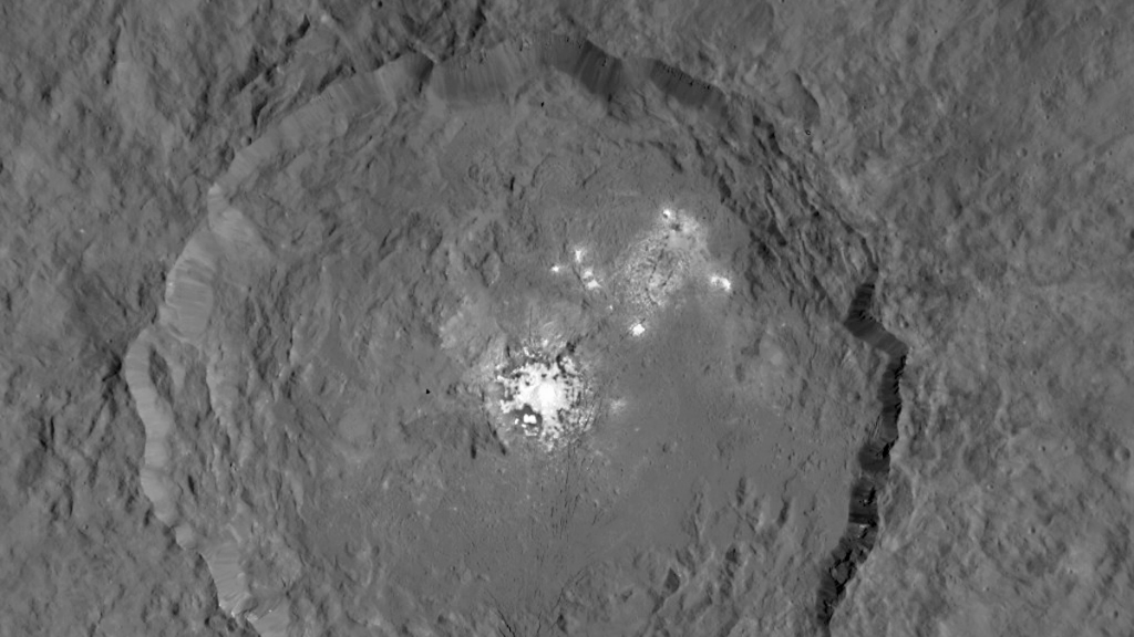 Occator crater on asteroid 1 Ceres with its conspicuous bright faculae. NASA-JPL image 20150909/PIA19889-16.