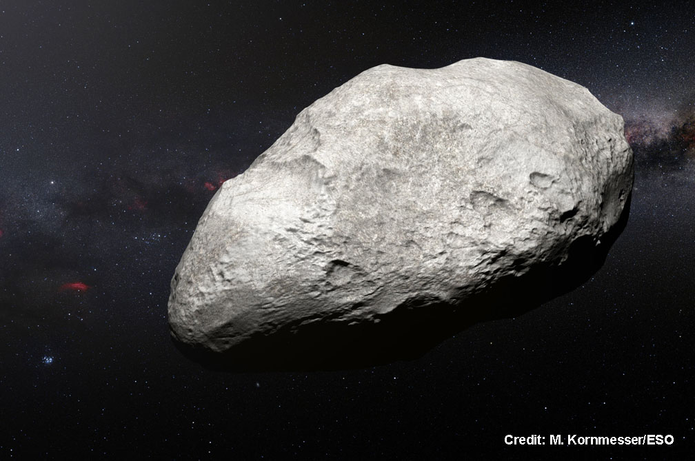 This artist??™s impression shows the exiled asteroid 2004 EW95, the first carbon-rich asteroid confirmed to exist in the Kuiper Belt and a relic of the primordial Solar System. This curious object likely formed in the asteroid belt between Mars and Jupiter and must have been transported billions of kilometres from its origin to its current home in the Kuiper Belt.