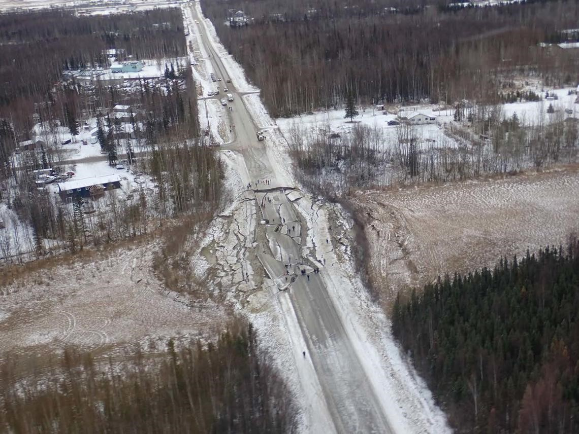 Disrupted road near Wasilla, Alaska as a result of liquefaction of lowlands filled with sediment, silt, or sand. Image credit: Rob Witter/USGS