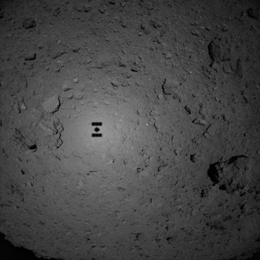 Hayabusa casts a shadow on Ryugu's surface in this image from October 25, 2018. Image credit: JAXA/ISAS