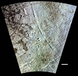 Fig. 1. Western portion of one of two known concentric circles on Europa believed to be due to true polar wander of the icy shell. The long arcuate trough or depression sweeping diagonally across the top of the scene is roughly 40 kilometers wide and 500 kilometers long. A smaller deeper depression lies just to the west near the top of the frame. This Voyager-Galileo mosaic has an effective resolution of 1.5 kilometers. Scale bar is 100 kilometers long.